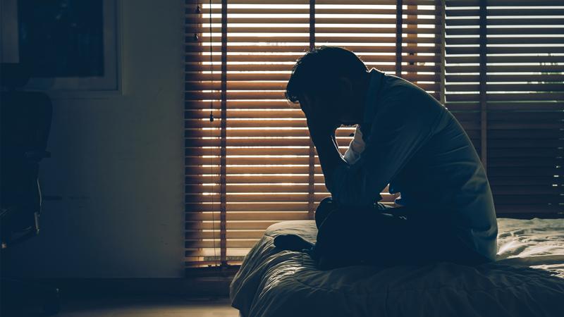 sad depressed man bedroom